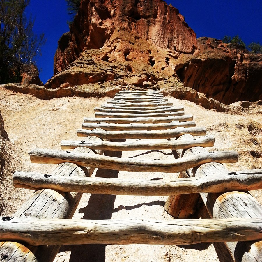 One of the ladders leading to the Alcove House Ceremonial Cave located 140-feet above the Frijoles Canyon floor of the 33,677-acre Bandelier National Monument in New Mexico. The cave was once home to ancestral Pueblo people during the years 1250-1600 A.D.