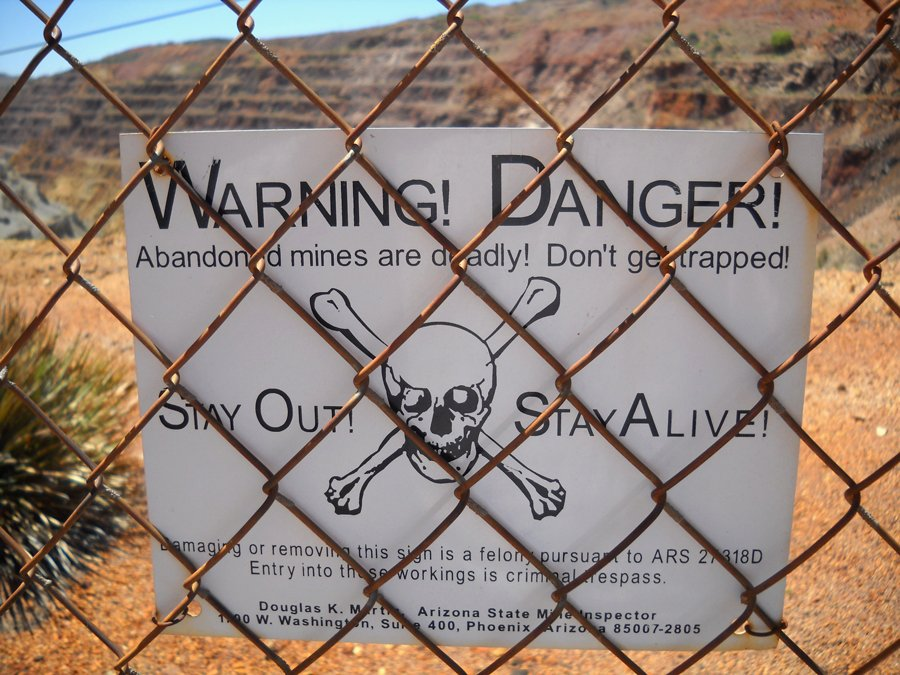 Some photos write their own captions. This warning sign was posted on the outskirts of Bisbee, Arizona. Maybe this could be a good opening shot for a viral video? (Jain Lemos, Bisbee, AZ; 2014.)